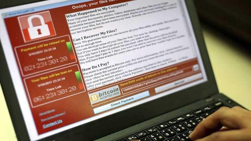 Een laptopscherm met een ransomwarebericht dat door een hacker is gestuurd