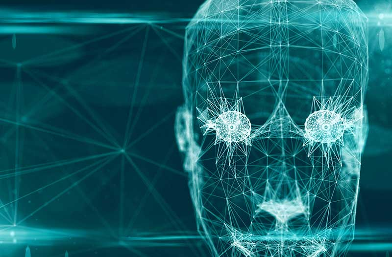Een digitale lichtgevende representatie van een menselijk hoofd tegen een donkerblauwe achtergrond