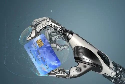 A robotic hand holding a credit card