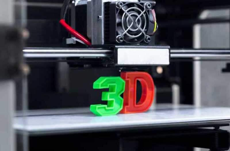 Een 3D-printer met een groene plastic nummer '3' en een rode plastic letter 'D'