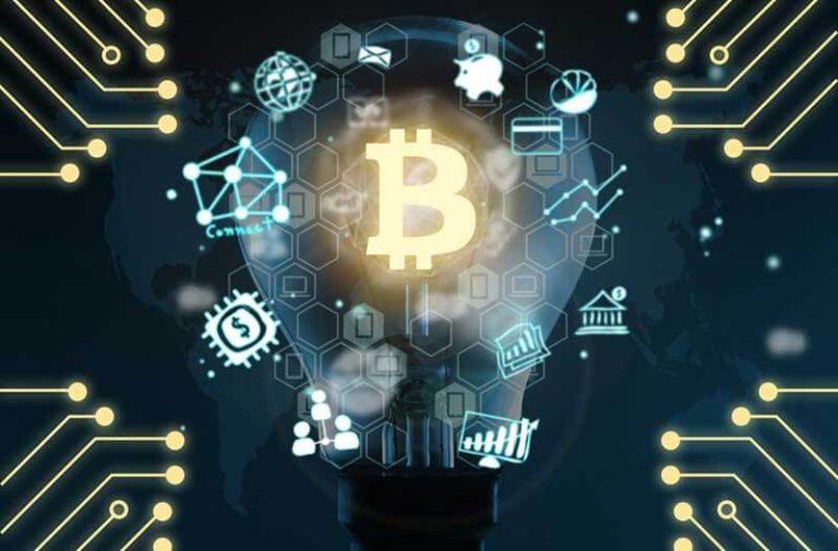 Gloeilamp met geldsymbolen en B van Blockchain