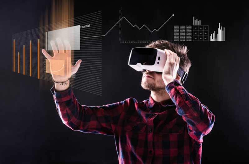 A person wearing a VR headset interacting with a holographic interface