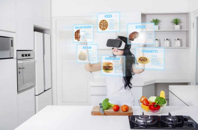 A young girl wears a VR headset in a kitchen and interacts with digital menus