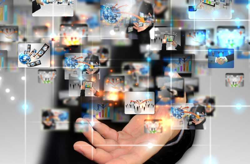 Digital icons floating aboves stretched-out hand