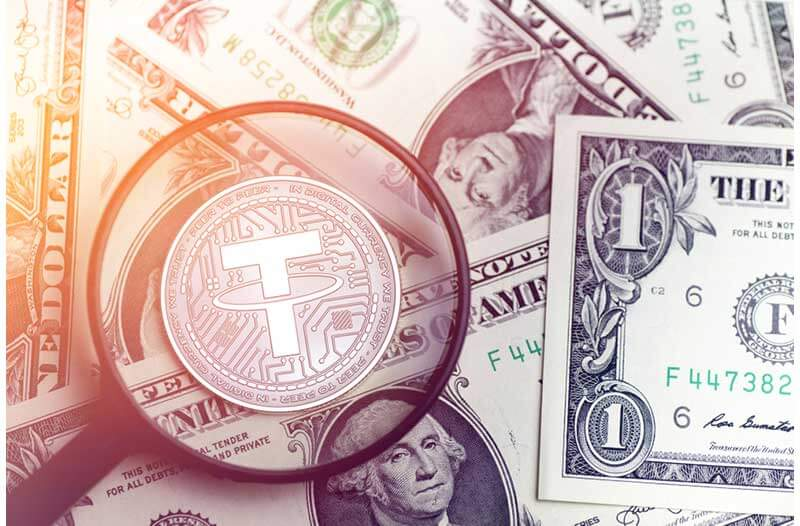 American dollar bills and cryptocurrency Tether