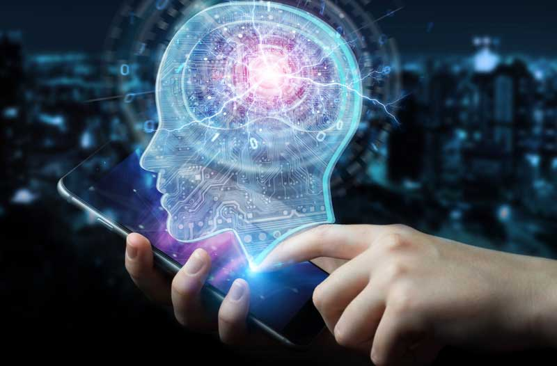 Two hands holding smartphone with hologram of human head and brain floating overhead