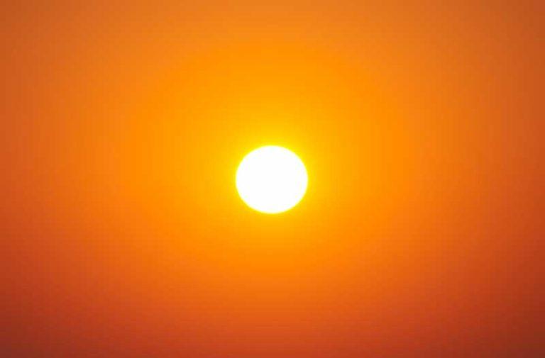The sun in an orange sky