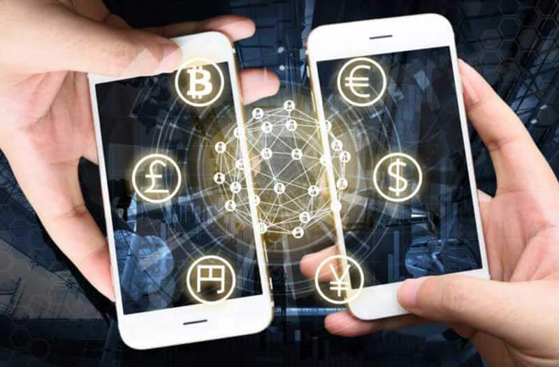 Two hands holding two smartphones with currency icons floating above their displays