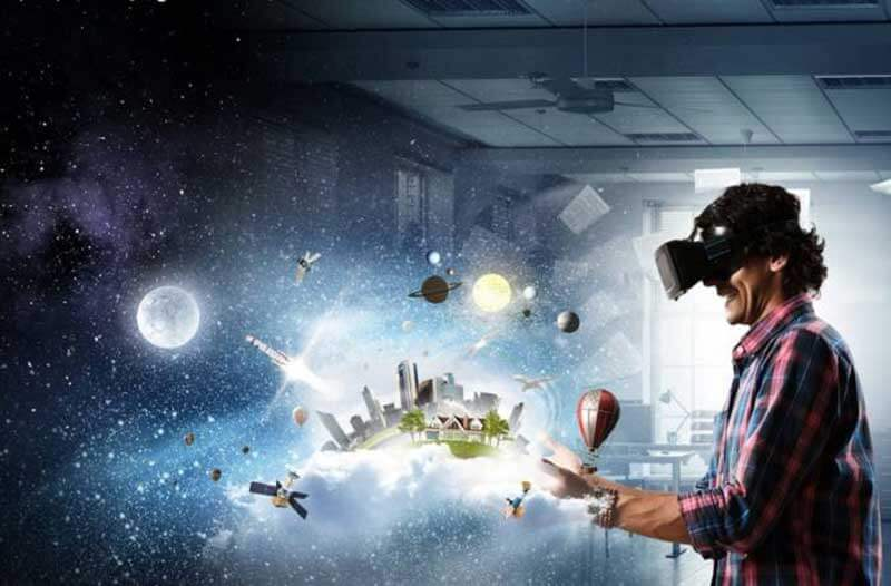 A man wearing a VR headset looking towards a digital illustration of a city skyline with planets and satellites