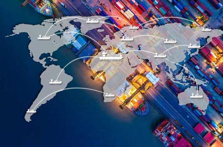 Aerial image of a shipping port at night with a digital overlay of the world map