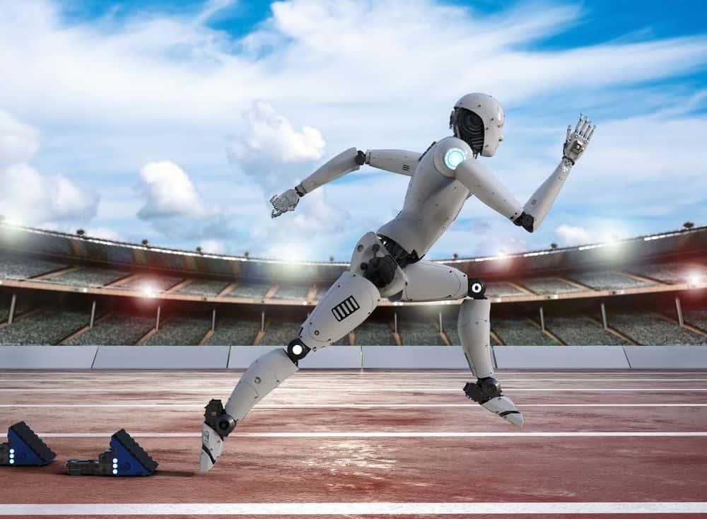 Een humanoïde robot trekt een sprint in een sportstadion