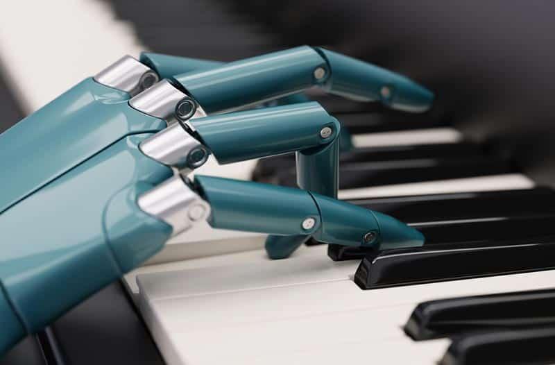 Een grijs-blauwe robothand speelt piano