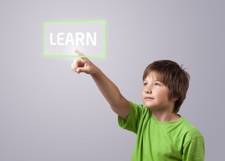Child in green shirt interacts with virtual 'learn' button floating in front of him