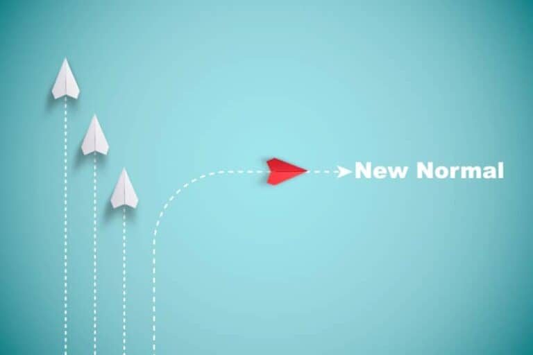 Three white paper planes and one red one with the words 'now' and 'normal'