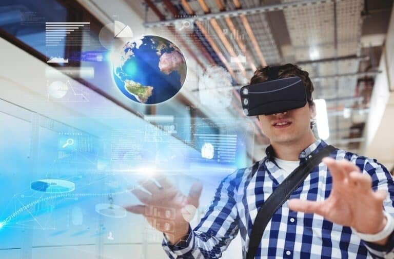 A man wearing a headset is immersed in a virtual world with planet Earth floating in front of him