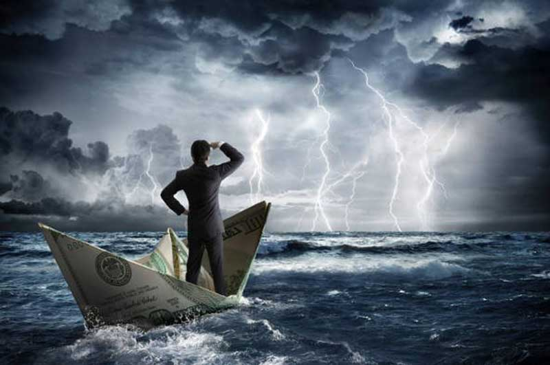 A man floating in a boat made from a dollar bill during a thunderstorm, looking towards lightning and heavy clouds