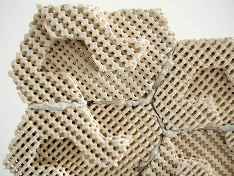 A close-up of a porous ceramic brick called Cool Brick