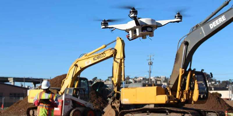 Construction site with excavating machines and a drone