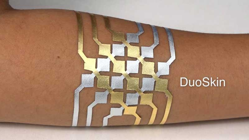 Temporary tattoo called DuoSkin on a human arm