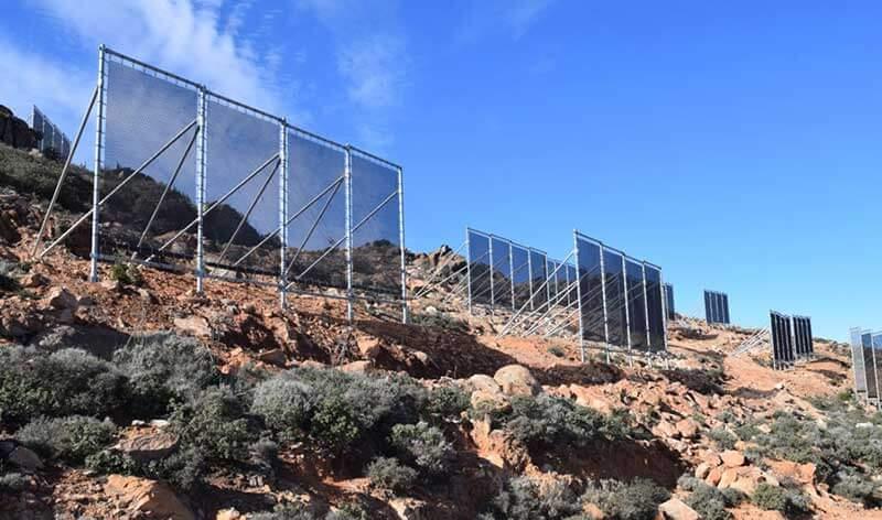 Mesh screens capture air moisture Mount Boutmezguida