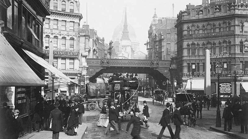 Black and white photo of crowded London streets during the first industrial revolution