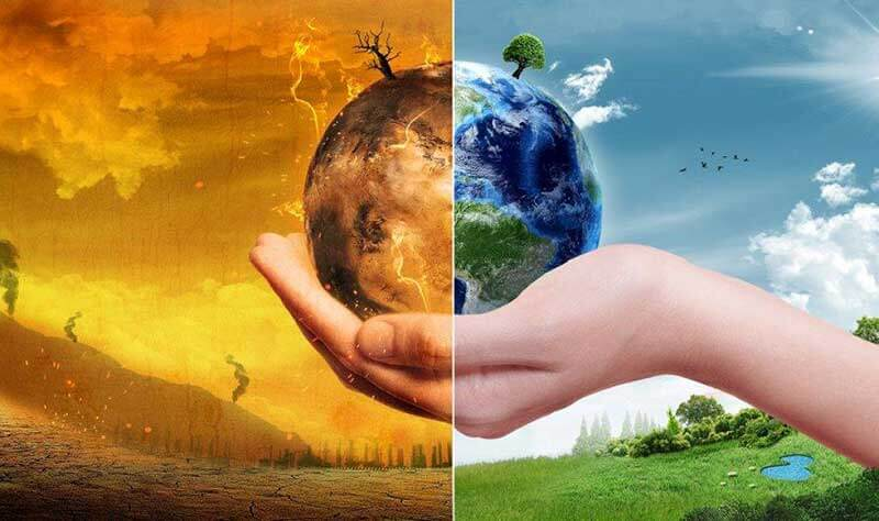 Human hand holding miniature Earth which is dry and impacted with wildfires on the left and green and healthy on the right