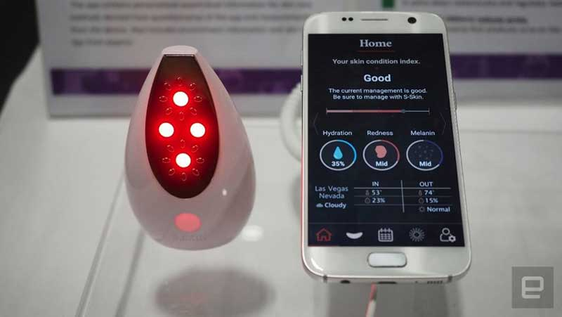 The S-Skin device with infrared LED lights connected to an app featured on a smartphone